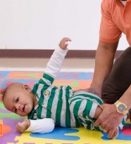 baby-rolling-with-assitance-at-knee-small-300x300.jpg